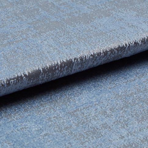 Folded grey coloured fabric layered with light blue in a textured appearance