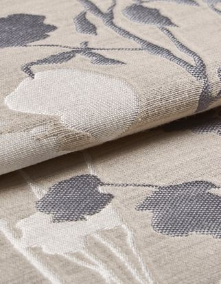 Beige coloured fabric patterned with flowers in grey and white