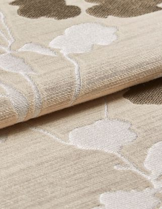 Beige colour fabric with a floral design in white and brown that repeats across the material