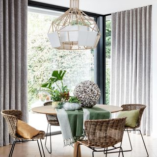 Grey wave header curtains over a patio door in a contemporary dining room