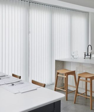Dining kitchen with textured alma white vertical blinds on patio doors