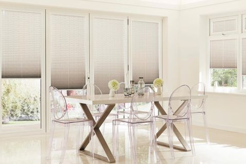 Dining room with perfect fit grey studio pleated blinds on doors and windows