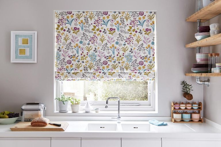 Kitchen with floral print ester hollyhock roman blinds at window