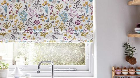 kitchen with floral print ester hollyhock roman blind at window