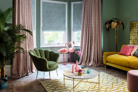 Romari Peach curtains with Mineral Azure Roman blinds in a retro sitting room