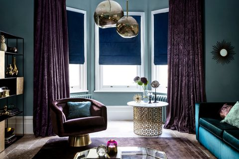 Broadleigh Aubergine curtains with Radiance Midnight Roman blinds in a luxurious sitting room