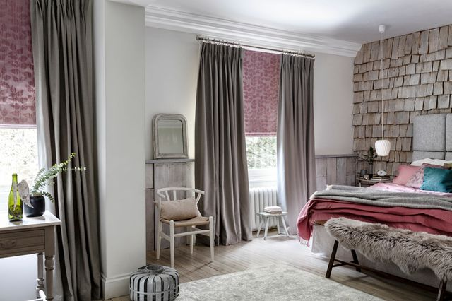 Harlow Charcoal curtains with Roche Blush Roman blinds in a cosy bedroom
