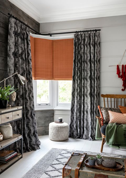 Clarence Terracotta Roman blind with Cadillac Noir curtains hung in the corner of a study