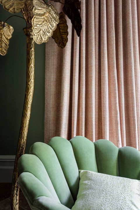Romari Peach curtains hanging behind a mint-green velvet chair