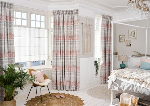 Ombre Natural Roman blinds with Fjord Coral curtains in an English country-style bedroom