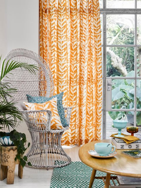 Isra Amber curtains hanging in a cosy bright dining room