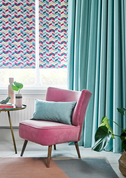 Jazz Fuchsia Roller blinds with Harlow Turquoise curtains in a bright 60s bedroom