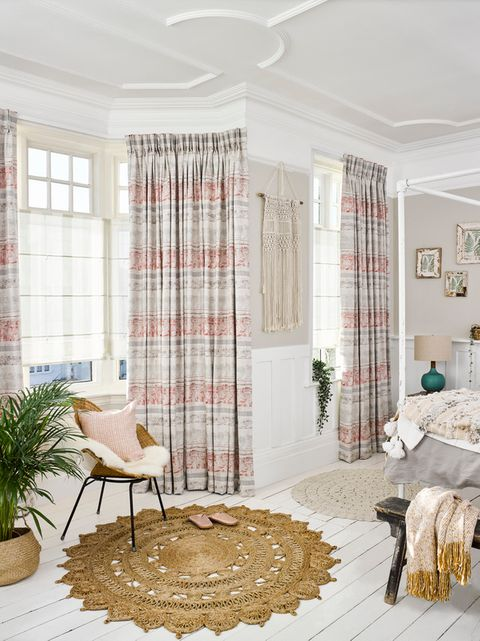 Ombre Natural Roman blinds with Fjord Coral curtains in a rustic bedroom