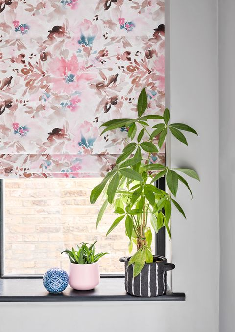 Caprice Soft Pink blind hanging in a hall