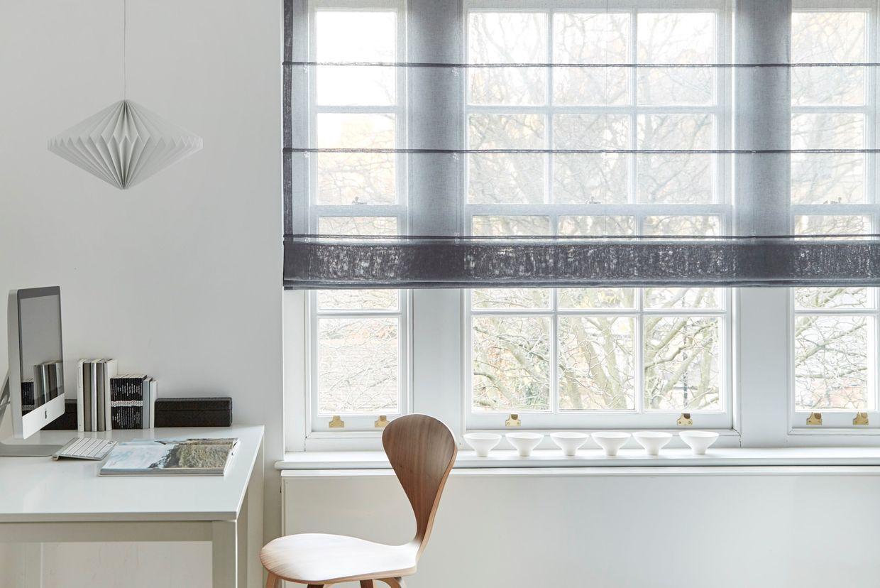 voile roman blinds in a white room