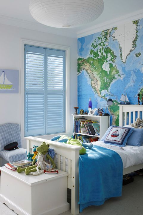 light blue shutters dressed on windows of kids white bedroom