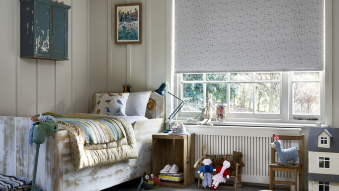 hillarys white patterned roller blind in a bedroom window