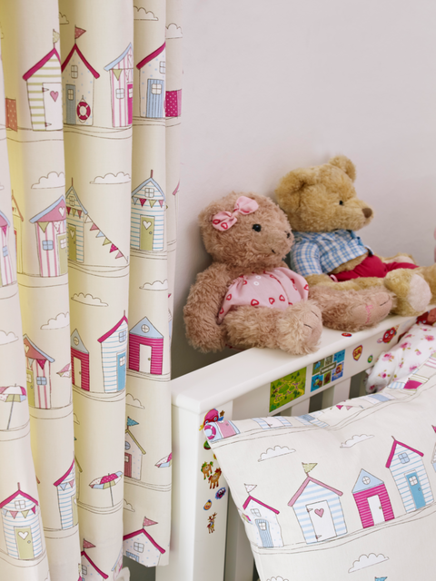 Two teddy bears in a Children's Bedroom next to a window with Pink Printed Blackout Curtains