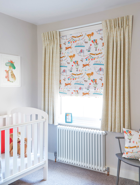 Child's nursery with colourful decor and yellow children's curtains