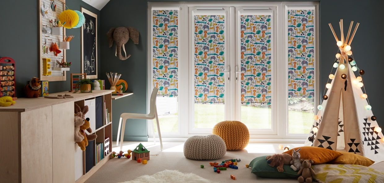 Childs playroom with PerfectFit blinds on the doors in Jungle Book Safari cartoon animal print