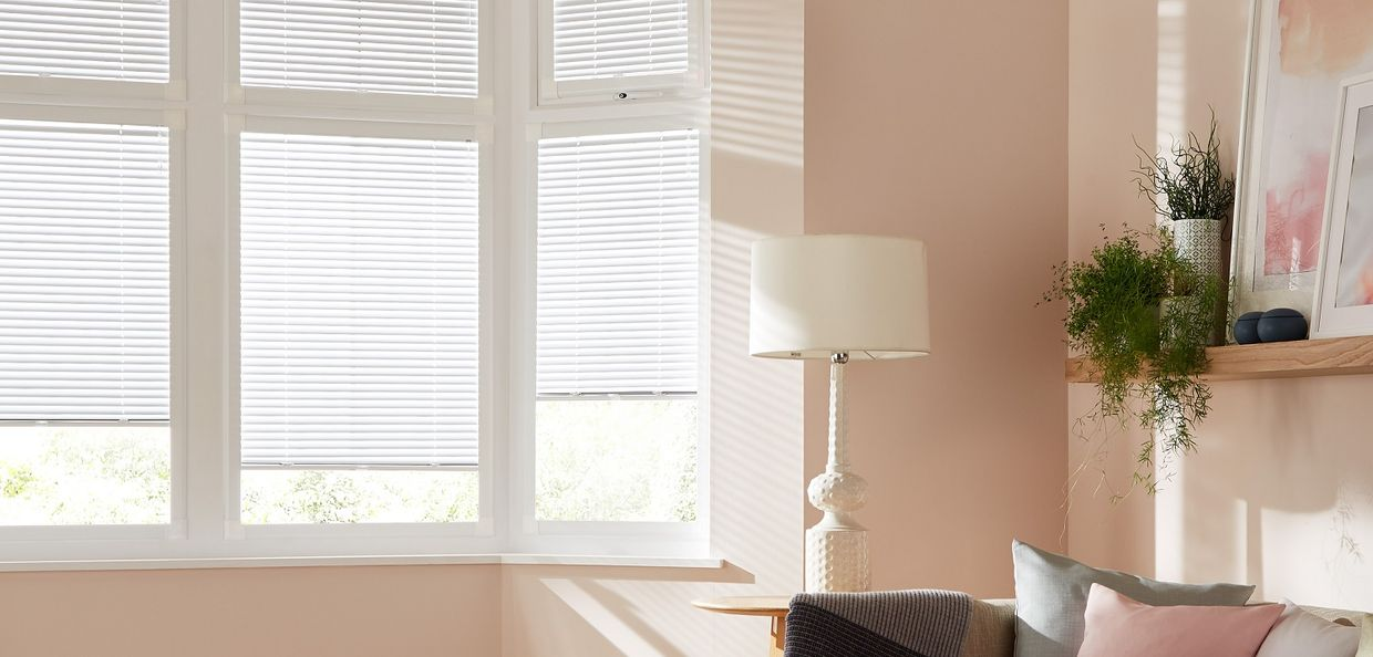 framed venetian blinds in a modern living room window