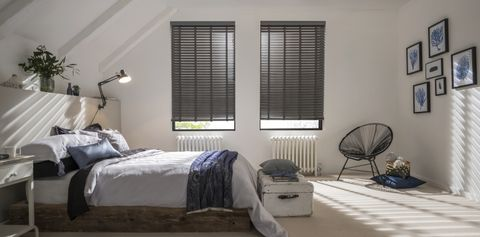 Large bedroom with contrasting dark grey wooden blinds