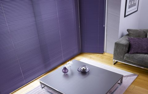 Living room with venetian blinds in a beautiful purple damson colour