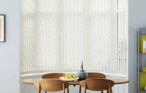 Retro style dining room with floral vertical blinds