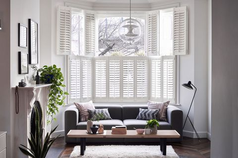 Windsor Silk White tier-on-tier shutters in a living room