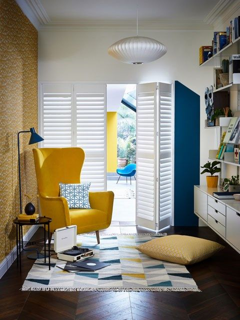 Vellum tracked Shutters in a living room