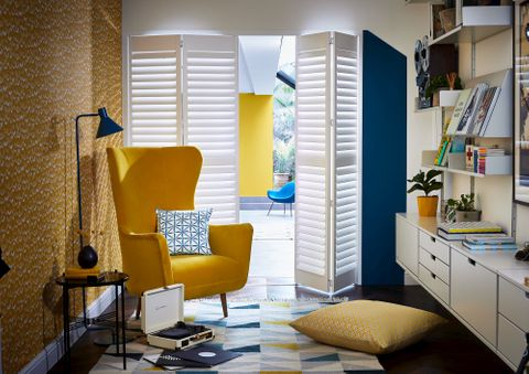 Vellum tracked Richmond shutters in a living room