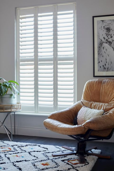 white full height shutters in a stylish landing window