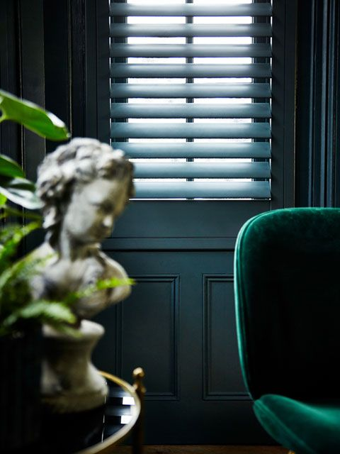 Closeup of custom colour blue shutters