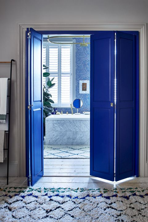 Bright blue solid shutters in bathroom