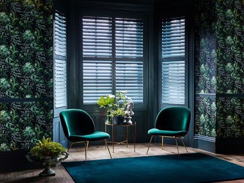 Custom colour shutters in blue in living room