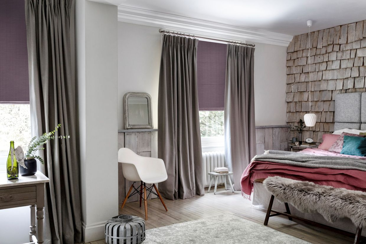 Hillarys brown curtains in a bedroom with pink roman blinds