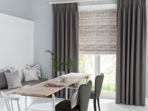 Dining room with Tetbury Charcoal curtains and Fjord Dusk Roman blinds