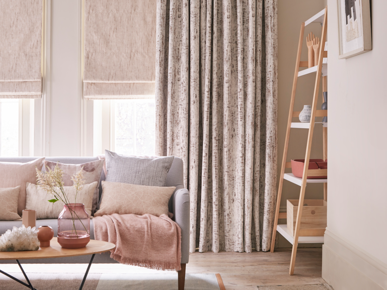 Cosy pastel colour living room with luxury pink velvet curtains
