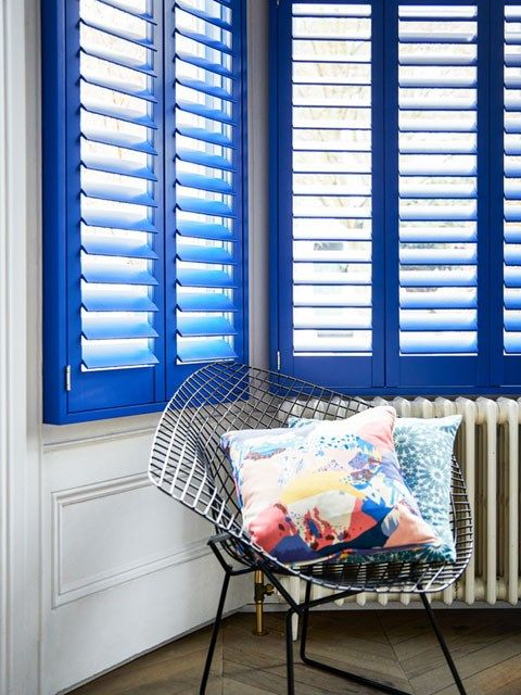 Blue custom colour full height shutters in living room