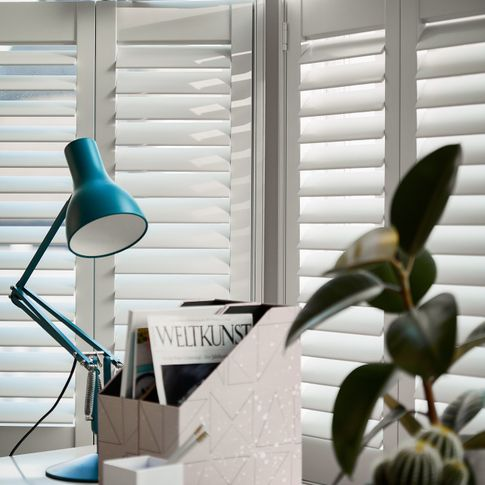 Ice tier on tier shutters in home office