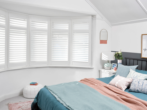 Silk white full height shutters in bedroom window