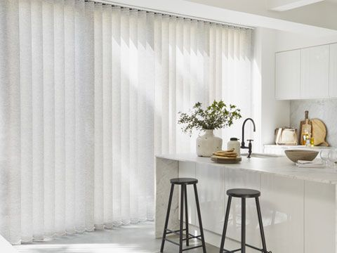 White Vertical blinds hung in kitchen