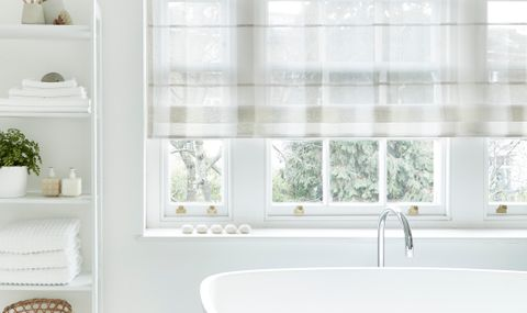 Bathroom room-set with an Ombre Natural Voile Roman Blind
