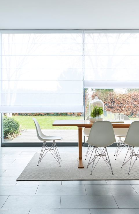 Dining room with a White Voile Roman blind