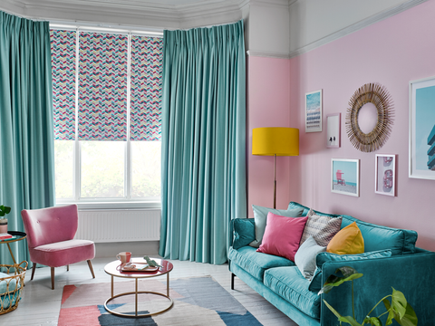 Harlow Turquoise curtains and Jazz Fuchsia Roller blinds in retro sitting room