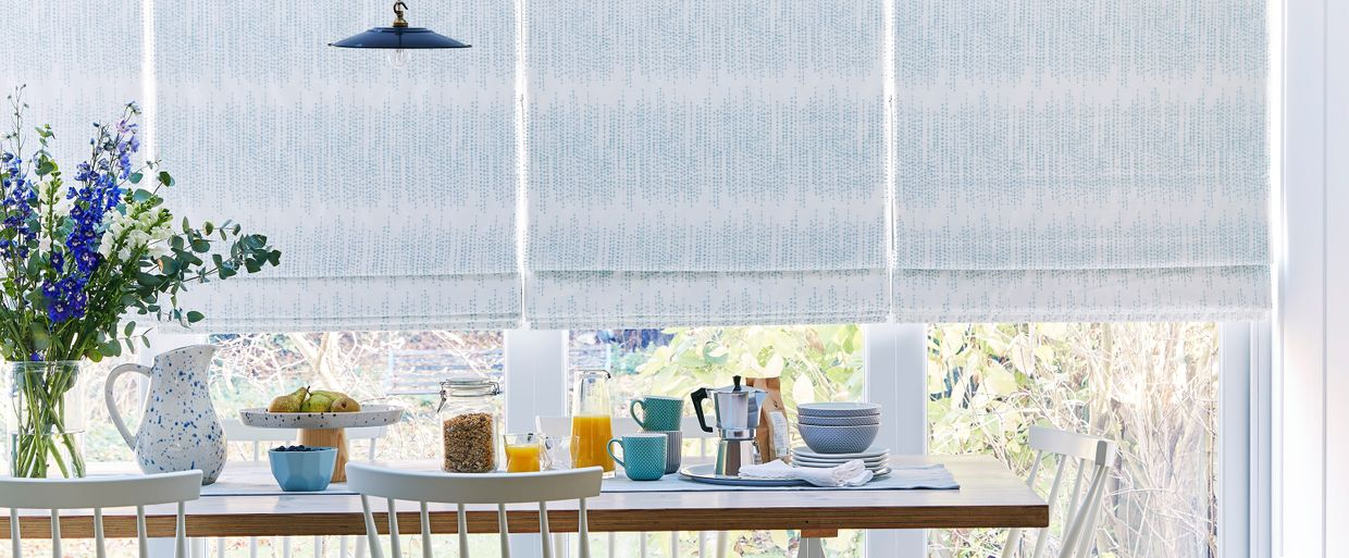 Dining room with a Serenity Glacier Roman blind