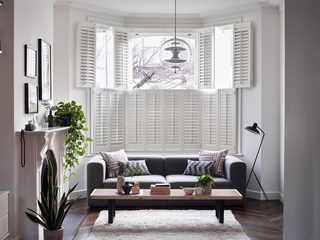 White tier on tier shutters in living room window