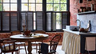 dark grey cafe-style shutters in kitchen dining room