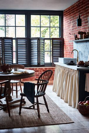 Grey cafe-style shutters in kitchen