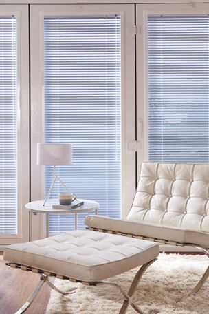 silver venetian blinds in a modern living room window